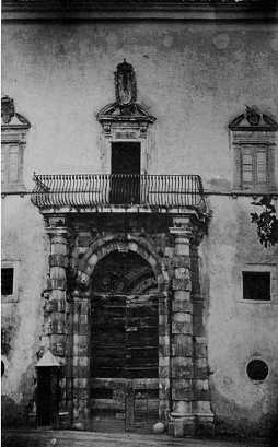 Photo: 1850 ca. Main entrance to the Abbey. Post-Napoleonic Militia settlement to becoming a Deposit of Mendicity. A soldier booth on the bottom left can still be noticed. credits: ArchiviodellaSovrintendenzaaiBeniCulturali, Storici e Artisticidell 'Abruzzo